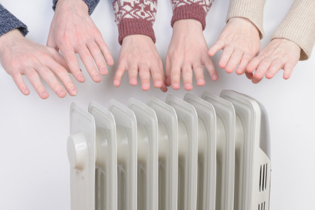 Guys warming their hands over the best Oil Filled Radiator