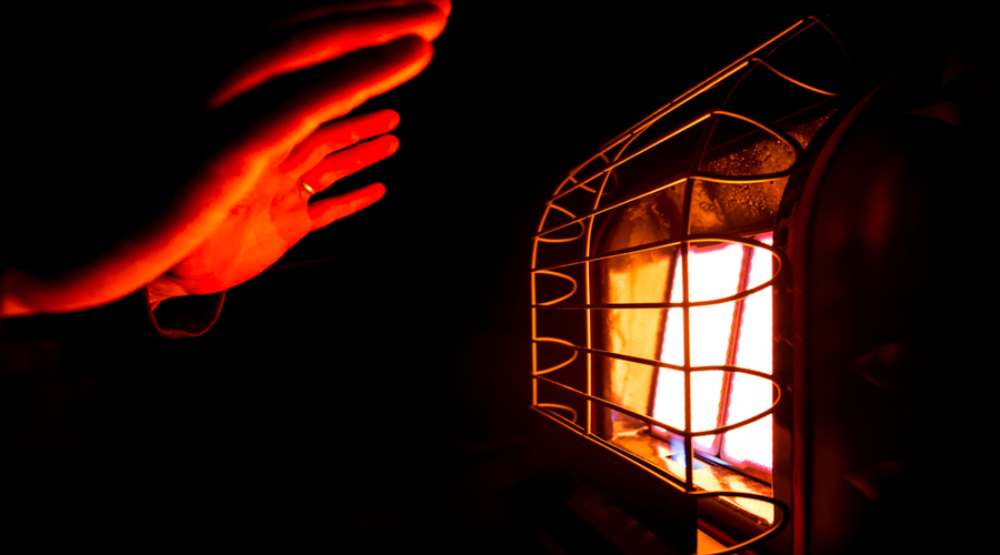 warming a hand using natural gas heaters for homes