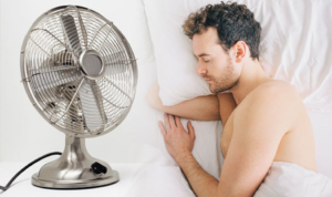 Man enjoying good sleep with the best fan with white noise in his bedrrom