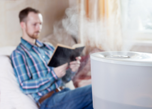 a man reading near the best humidifiers for hard water