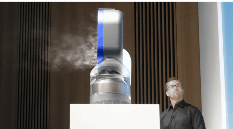 A man inspecting a humidifier with UV light